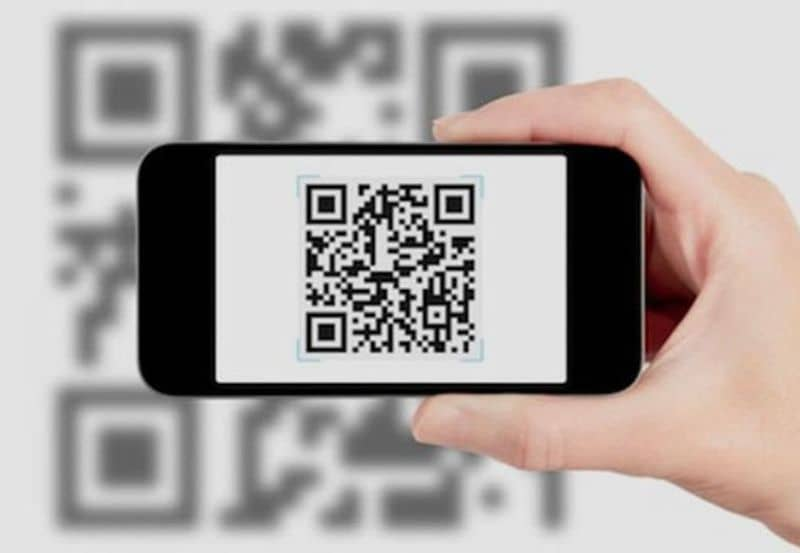 Phone in hand with QR Code with JS Wifi