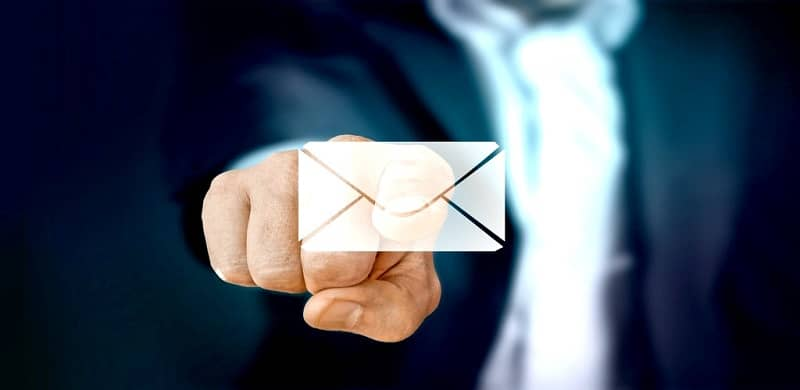 Man pressing send mail