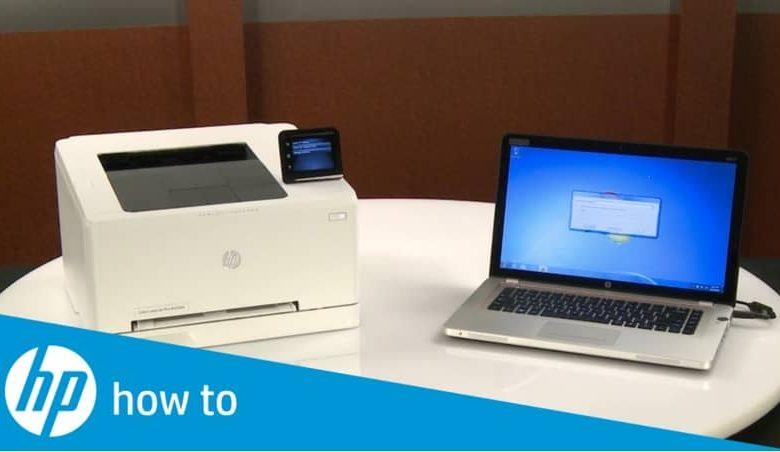 White printer, laptop