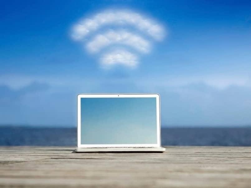 laptop with blurry weak wifi signal