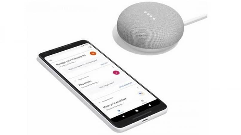 Android smartphone with speaker next to it