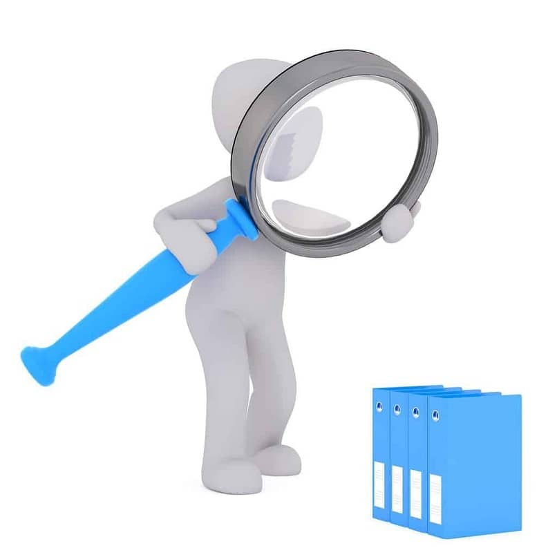 silhouette of person with a magnifying glass looking at windows pkg files
