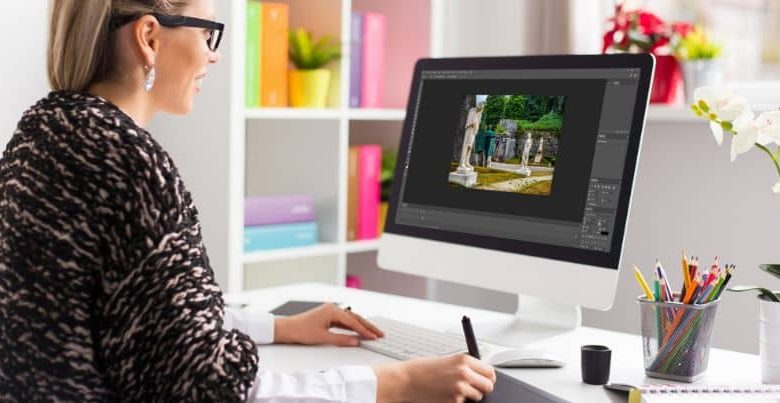 Woman editing on her Mac