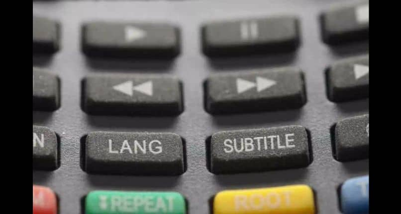 remote control with buttons for language and subtitles