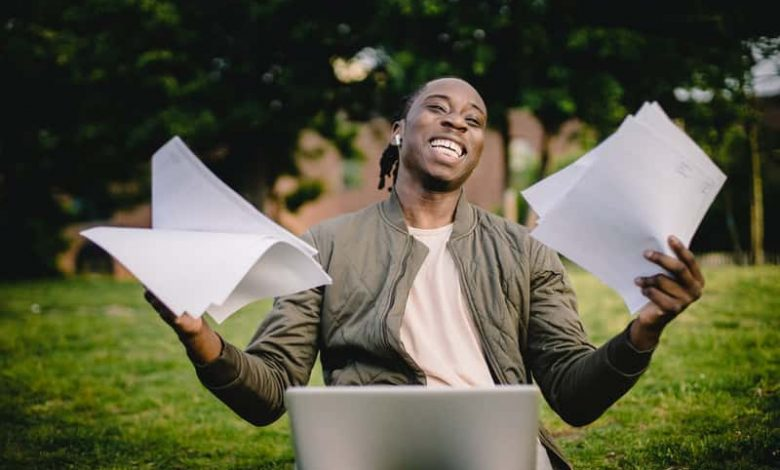 happy college student prints his works on multifunction printer