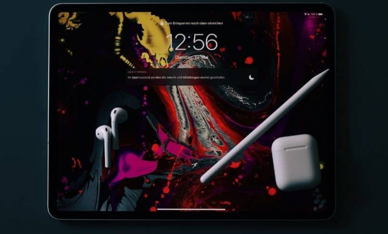 ipad with airpods and ipen