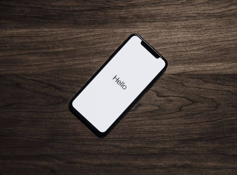 iphone in startup on wooden desk