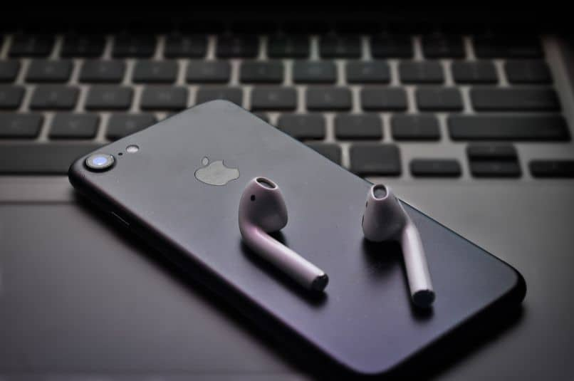 aipods iphone and black laptop