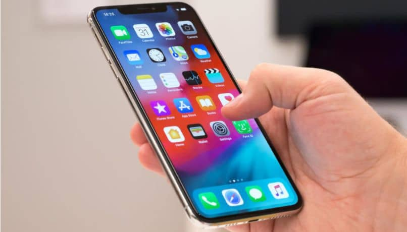 iphone with apps in hand