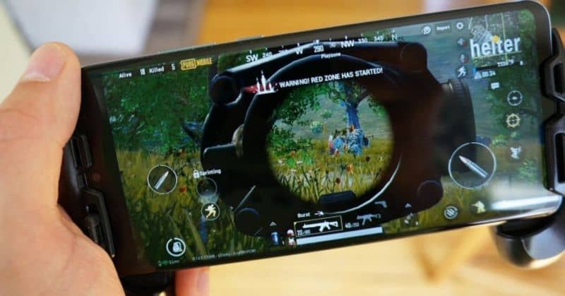 mobile with open video game blurred background