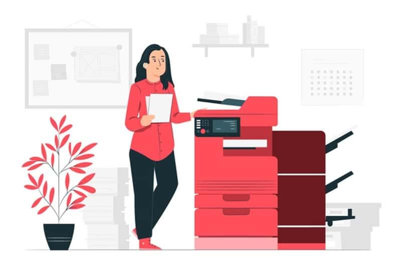 female college student prints on multifunction printer