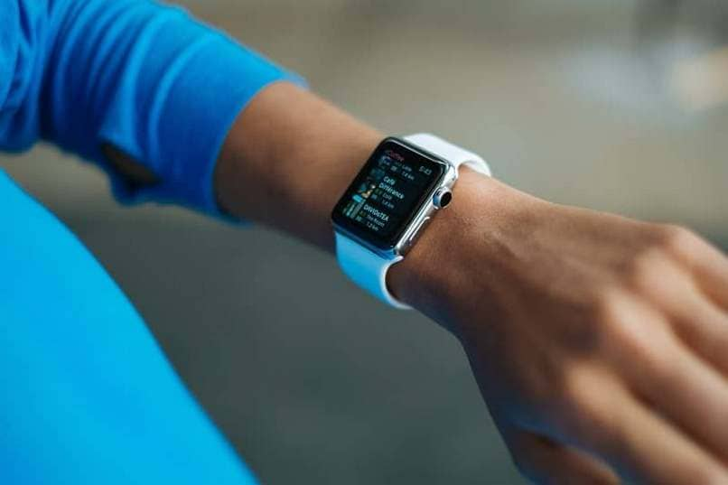 person wrist watch apple watch