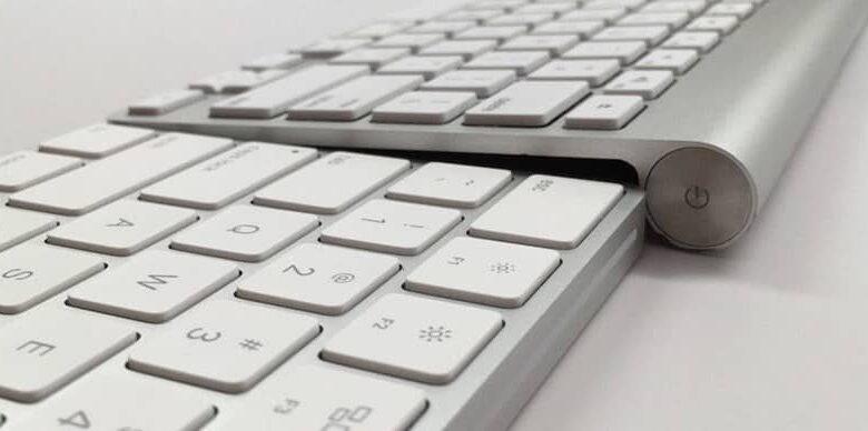 two apple keyboards