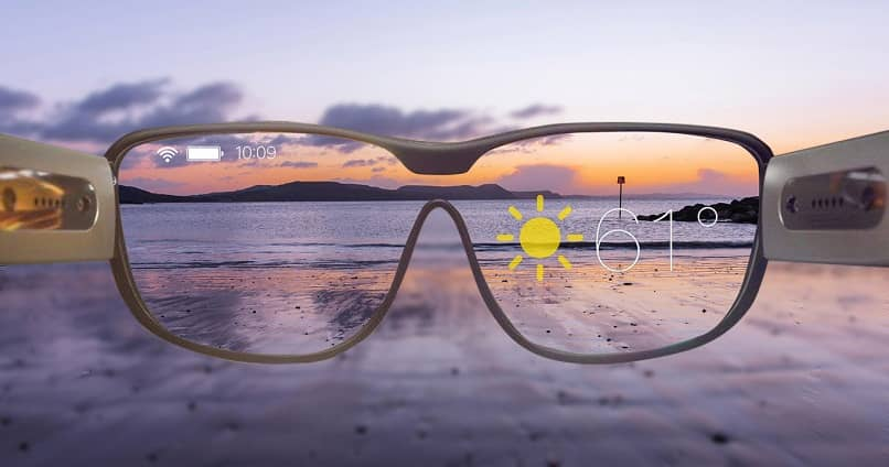 observation through lenses of a sunny beach landscape with augmented reality