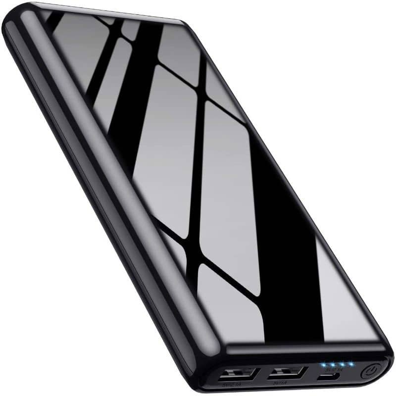 black power bank with reflection on its surface and ports on the bottom