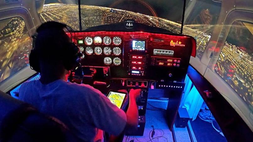 person practicing in flight simulator