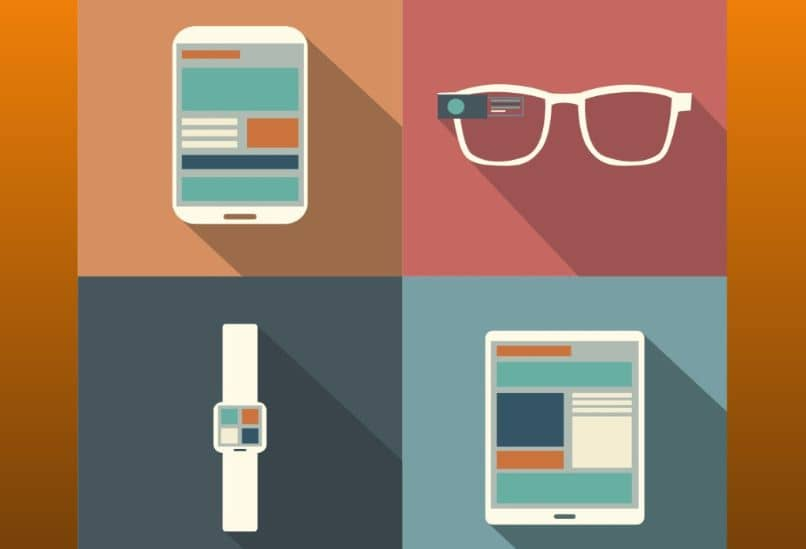 tablet mobile watch glasses orange background