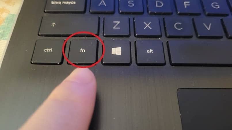finger pointing to the fn key