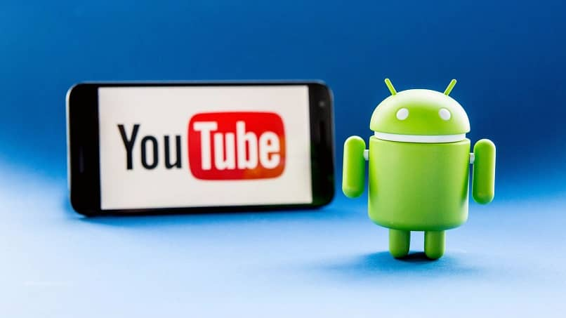 a background cell phone with the youtube application with the android logo